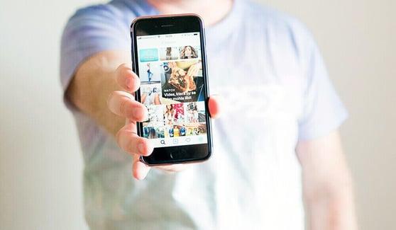 man-holding-phone-instagram-screen
